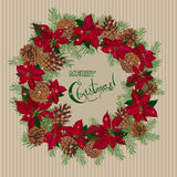 Vintage Christmas card with wreath of pine cones and puansetia Royalty Free Stock Images