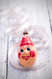 Vintage Christmas clown decoration on painted wood Stock Photo