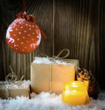 Vintage Christmas Composition with gift boxes wrapped in kraft paper and candle Royalty Free Stock Photography