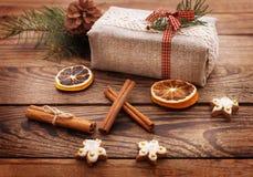 Vintage Christmas Composition. Handmade gift box, red ribbon, Stock Photography