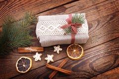 Vintage Christmas Composition. Handmade gift box, red ribbon, Stock Image