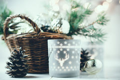 Vintage Christmas decor. Old Christmas decorations in a basket, lanterns, garlands and spruce branches on a white table stock photo