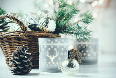 Vintage Christmas decor. Old Christmas decorations in a basket, lanterns, garlands and spruce branches on a white table Royalty Free Stock Photos