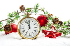 Vintage christmas decoration antique golden clock and red bauble. S on white background Stock Image
