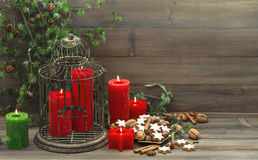 Vintage christmas decoration with candles and cookies Stock Images