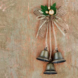 Vintage Christmas decoration hanging over wooden background Stock Photos