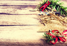 Vintage Christmas Decoration on natural wooden textured backgrou Stock Photos