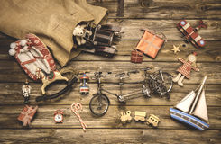Vintage christmas decoration: old nostalgic children toys on woo. Den rustic background stock photos