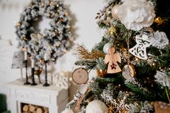 Vintage christmas decoration on festive background.figure of a wooden Christmas angel on a christmas tree. Beautifyl stock image