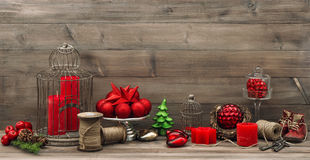 Vintage christmas decoration with red candles, stars and baubles Stock Photo