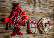 Vintage christmas decoration: red, white things on wooden backgr Royalty Free Stock Photo