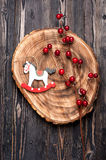 Vintage christmas decoration rocking horse over wooden background Stock Images
