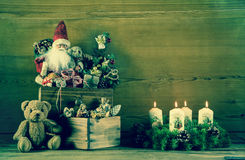 Vintage christmas decoration with santa and advent wreath on woo Royalty Free Stock Photos
