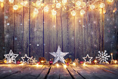Vintage Christmas Decoration With Stars And Lights. On Wooden Table stock image