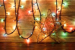 Vintage Christmas Decoration With Stars And Lights On Wooden Table Royalty Free Stock Photography