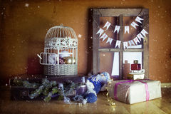 Vintage christmas decoration with suitcase, window and cage Stock Images