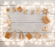 Vintage christmas decoration on wooden table - gift boxes, angel Stock Images