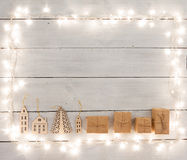 Vintage christmas decoration on wooden table - gift boxes, house Stock Images
