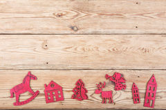 Vintage christmas decoration on wooden table - Xmas tree, houses Royalty Free Stock Photography