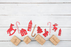 Vintage christmas decoration on wooden table - Xmas tree, houses Royalty Free Stock Image