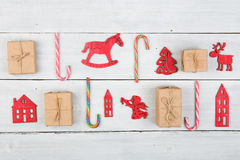 Vintage christmas decoration on wooden table - Xmas tree, houses Stock Images