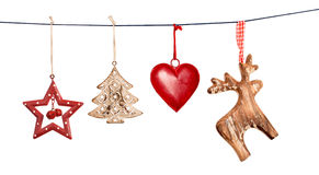 Vintage Christmas decorations hanging on string isolated. On white background royalty free stock images