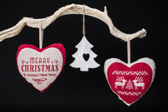 Vintage Christmas decorations hanging from tree branch Stock Photography