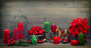 Vintage christmas decorations with red candles, stars and bauble Stock Photos