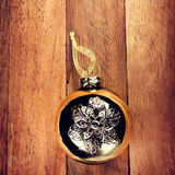 Vintage Christmas  decorations on wooden background. Golden ball Royalty Free Stock Photo