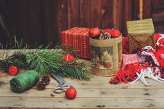 Vintage Christmas decorations at wooden country house. Preparing for New Year, wrapping gifts at home Royalty Free Stock Photography