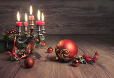 Vintage Christmas decoratons on wood. This image is toned Stock Photo