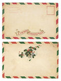 Vintage Christmas Envelope. The front and back of an aging Christmas envelope with red and green striped border. Isolated on white with clipping path Royalty Free Stock Photography