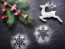 Vintage Christmas festive background with deer and snowflakes Royalty Free Stock Image