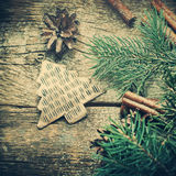 Vintage Christmas Fir Tree Toy, Pine Cones, Cinnamon, Branches of Coniferous on Wooden Background Stock Photos