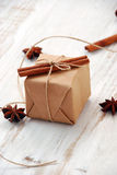Vintage Christmas gift box. On white wooden background Royalty Free Stock Photo
