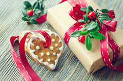 Vintage Christmas gift box and gingerbread cookies on wooden bac stock photos