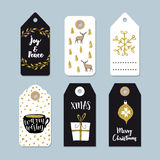 Vintage Christmas gift tags set. Hand drawn labels with golden Christmas holly wreath, deer, coffee and present. Isolated vector illustration objects Stock Image