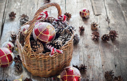 Vintage Christmas Gifts in Basket, Red balls, Pine cones, Sweet Candy toys Royalty Free Stock Photography