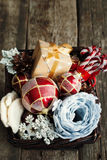 Vintage Christmas Gifts in a Basket Royalty Free Stock Photography
