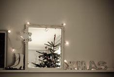Vintage Christmas Interior  Christmas Tree reflected in mirror Stock Images