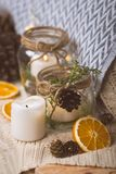 Vintage christmas interior decoration elements. Christmas vintage decoration elements with jars, candles ,oranges and cones on a blanket Royalty Free Stock Images