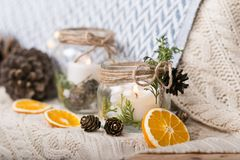 Vintage christmas interior decoration elements. Christmas vintage decoration elements with jars, candles ,oranges and cones on a blanket Stock Images