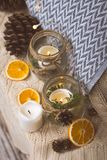 Vintage christmas interior decoration elements. Christmas vintage decoration elements with jars, candles ,oranges and cones on a blanket Stock Photography