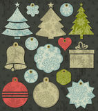 Vintage christmas labels over grunge brown backgro Stock Photo