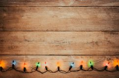 Vintage Christmas lights bulb decoration on old wood stock images