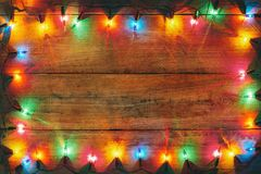 Vintage Christmas lights bulb decoration on old wood royalty free stock image