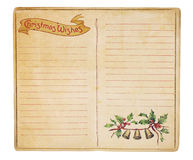 Vintage Christmas List Booklet. An aging Christmas wish list memo book opened to reveal blank, lined pages. Isolated on white with clipping path Stock Photography