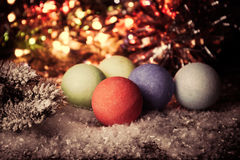 Vintage Christmas, New Year background with multi-color Christmas decorations on snow. Stock Photos