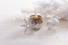 Vintage Christmas ornaments and candle over white background Stock Photo