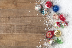Vintage Christmas Ornaments in a Snowdrift on Wood Background with Room or Space for Copy, Text, Words. Stock Image